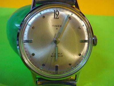 TIMEX 21 JEWEL WATERPROOF WRIST WATCH WITH FLEX TYPE BAND LUMINOUS HAND WIND